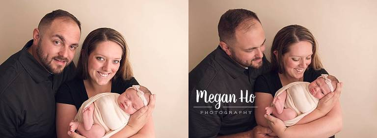 proud nh parents with their newborn baby girl in studio session
