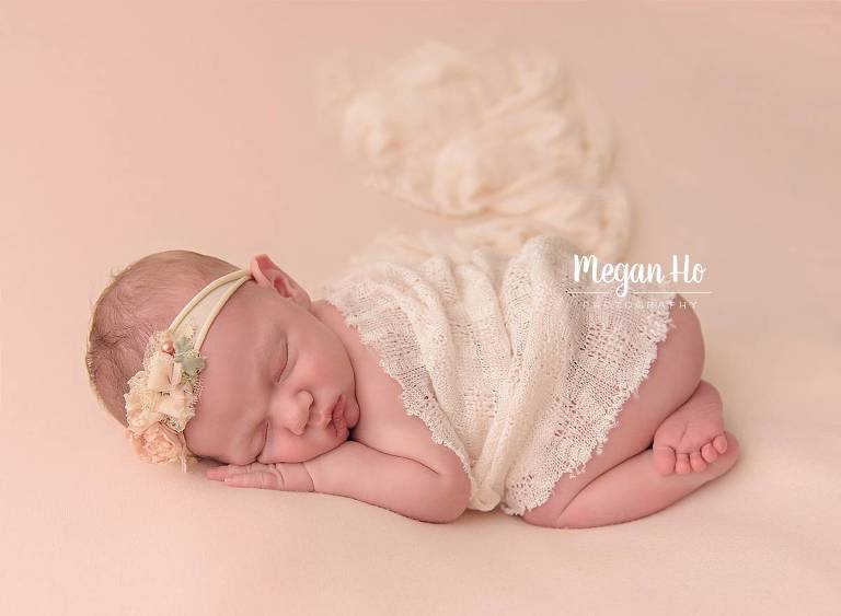 bedford nh newborn session baby girl in bum up pose with lace and flower headband