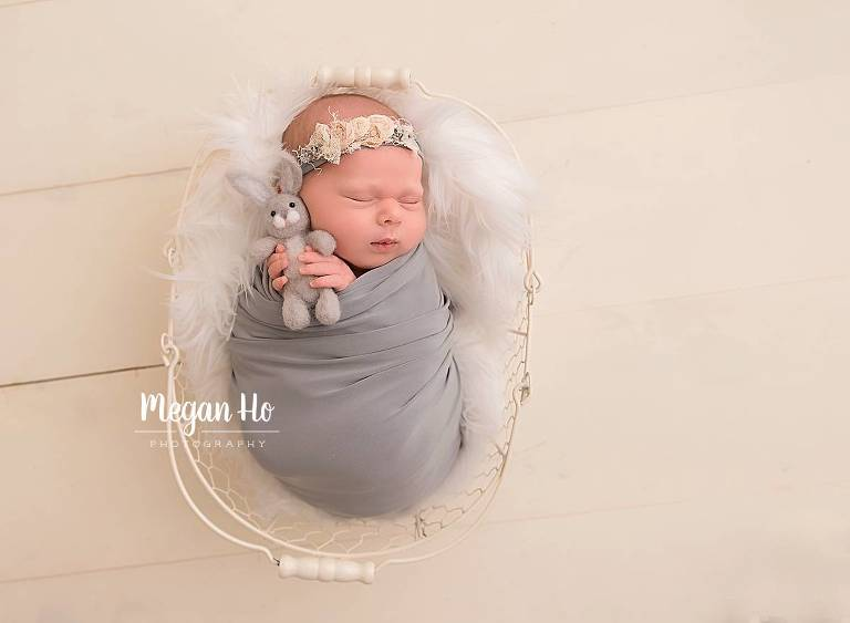 southern New Hampshire studio session newborn baby girl wrapped snuggling little bunny