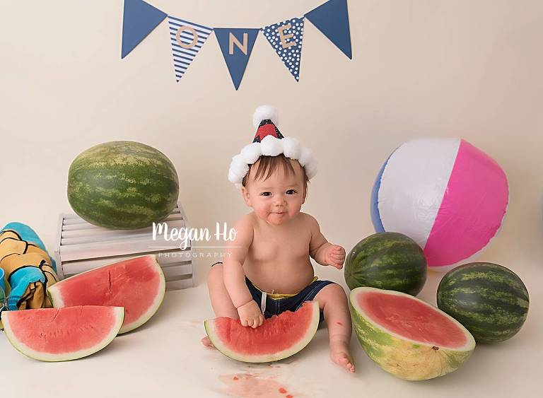 happy little boy digging into watermelon in southern nh studio