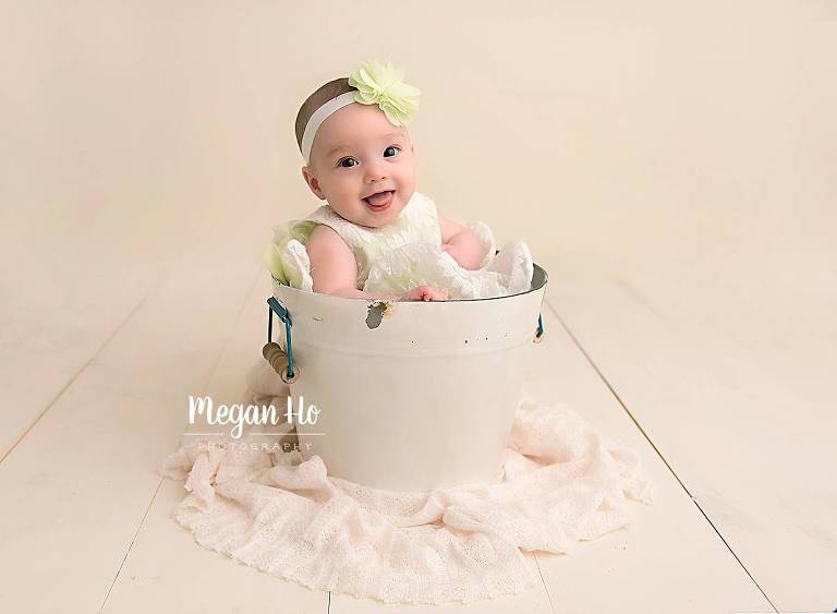 bedford nh milestone session smiling four month old in white bucket