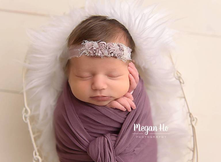 NH sleeping newborn session in purple wrap on white floor