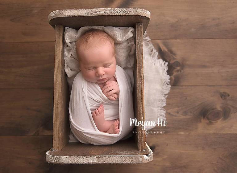 details of newborn baby boy sleeping in a tiny bed small details new hampshire