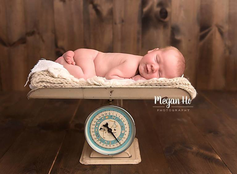 baby boy sleeping on antique scale in new hampshire newborn session