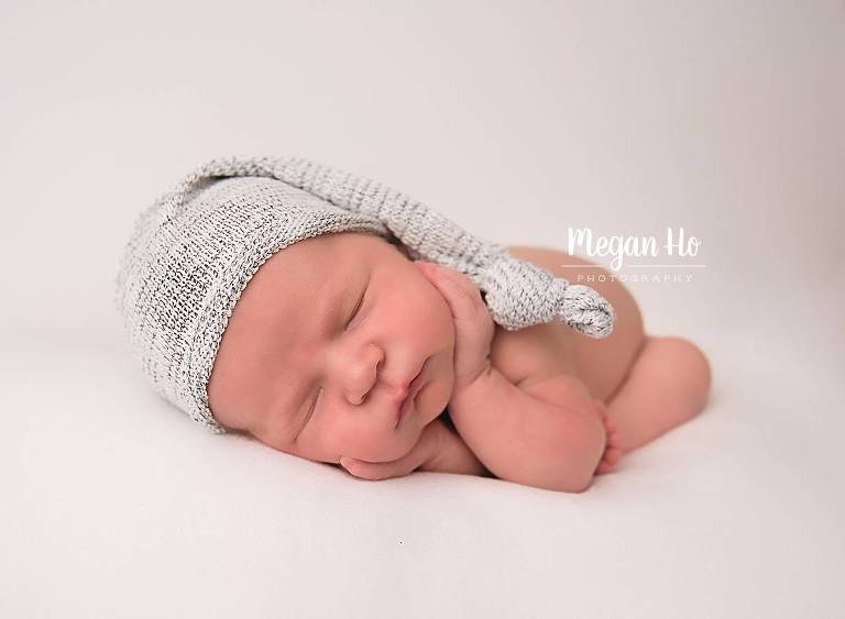 sleeping baby newborn boy in adorable hat in nh newborn session
