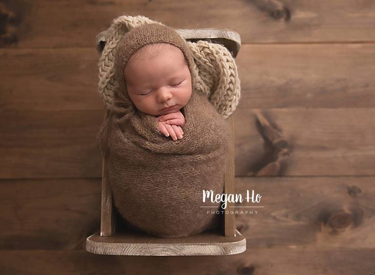 baby boy sleeping in little wooden bed southern nh newborn session