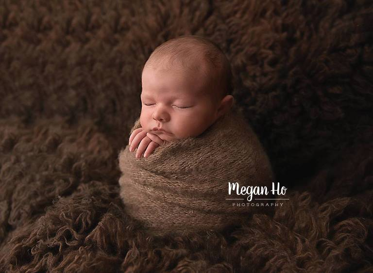 sleeping baby boy in newborn session new hampshire wrapped in brown
