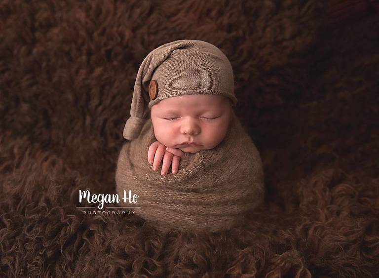 squishy baby swaddled on brown fluffy rug nh studio session
