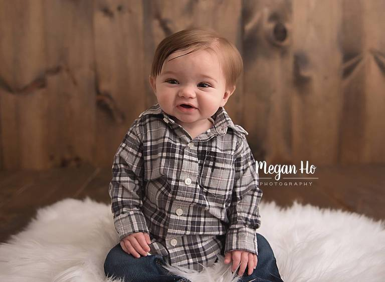 smiling little boy in plaid shirt in sitter milestone session bedford nh