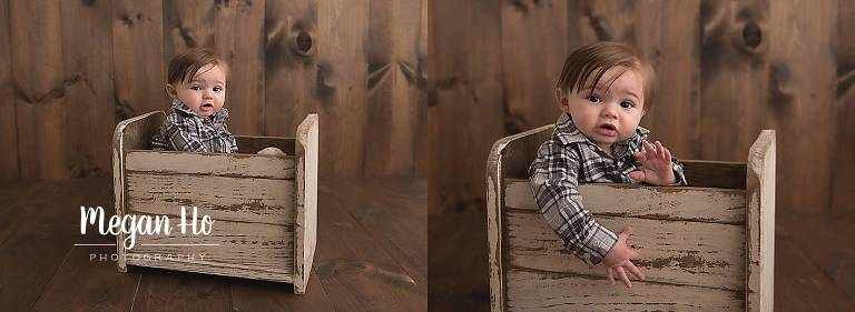 six month boy in plaid shirt sitting in little white bed in nh session
