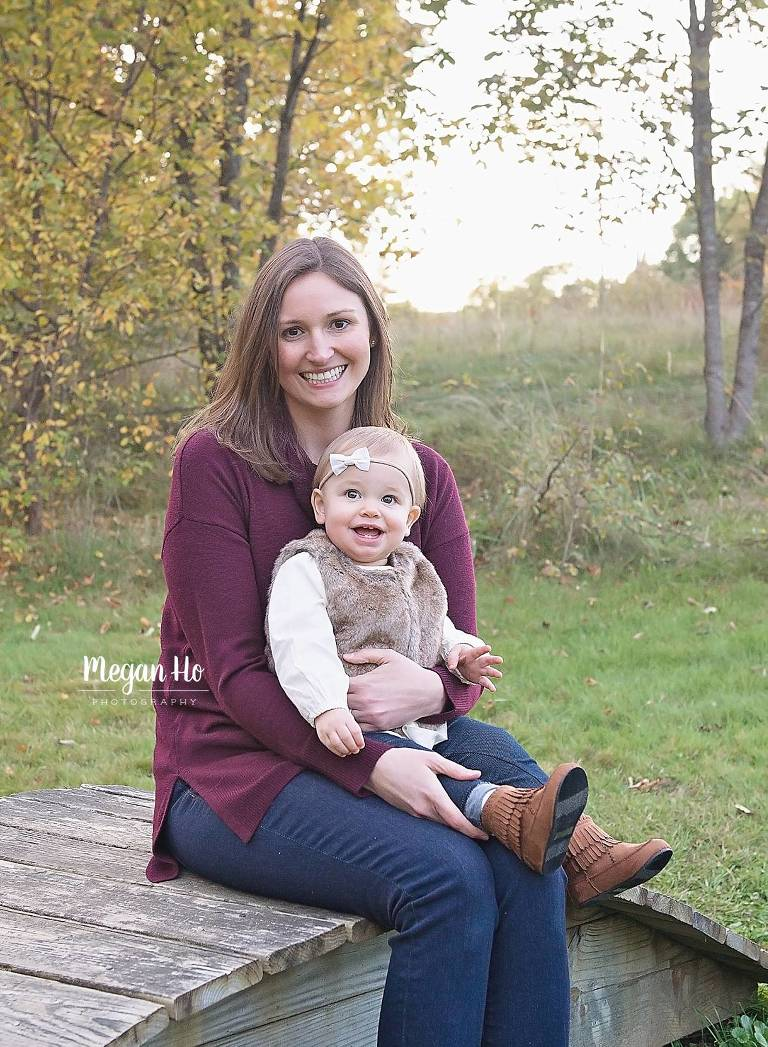 mom and beautiful daughter sitting on a beautiful October evening in new hampshire