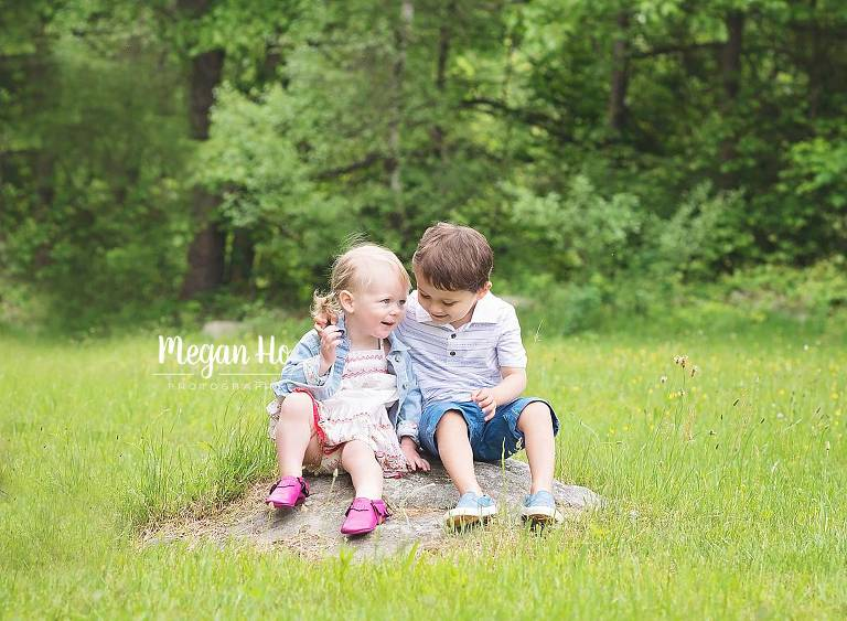 adorable kids sharing a secret in family session in Goffstown nh