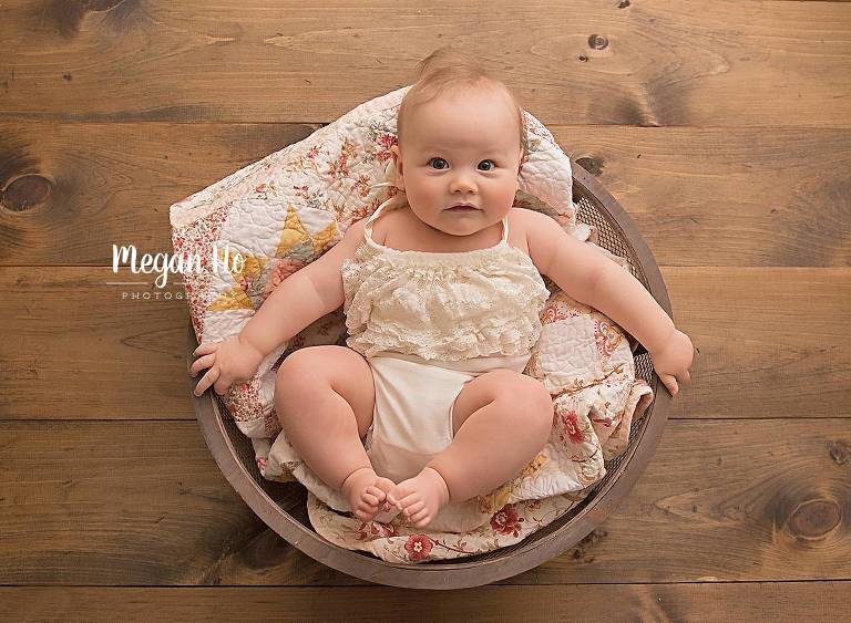 four month milestone session baby girl in bowl in bedford nh