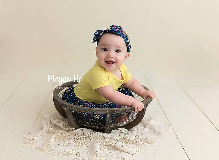southern nh studio six month girl smiling in bowl with headband and dress