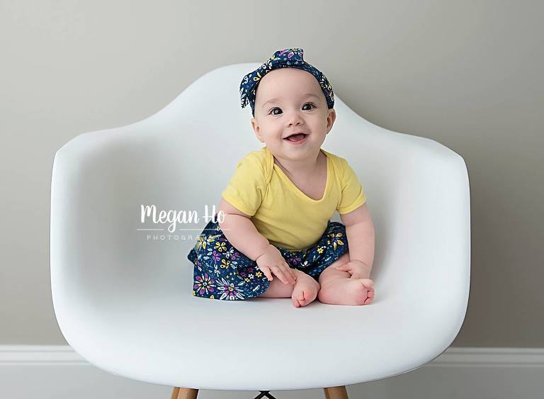 white chair with sitter baby girl in nh 6 month session