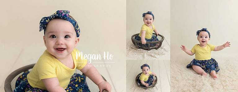 six month girl sitting in wire bowl on white wood floor