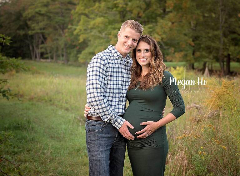 nh maternity family session beautiful mama to be in dark green dress with husband