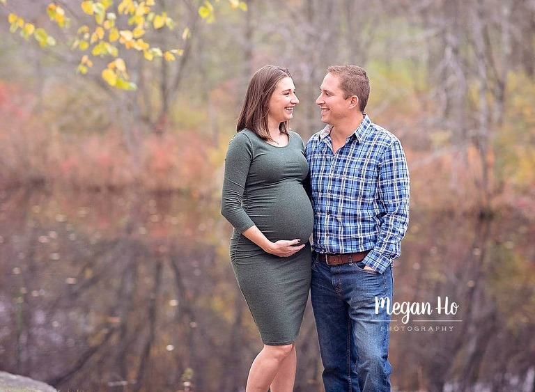 southern new Hampshire maternity session mom and dad smiling at each other