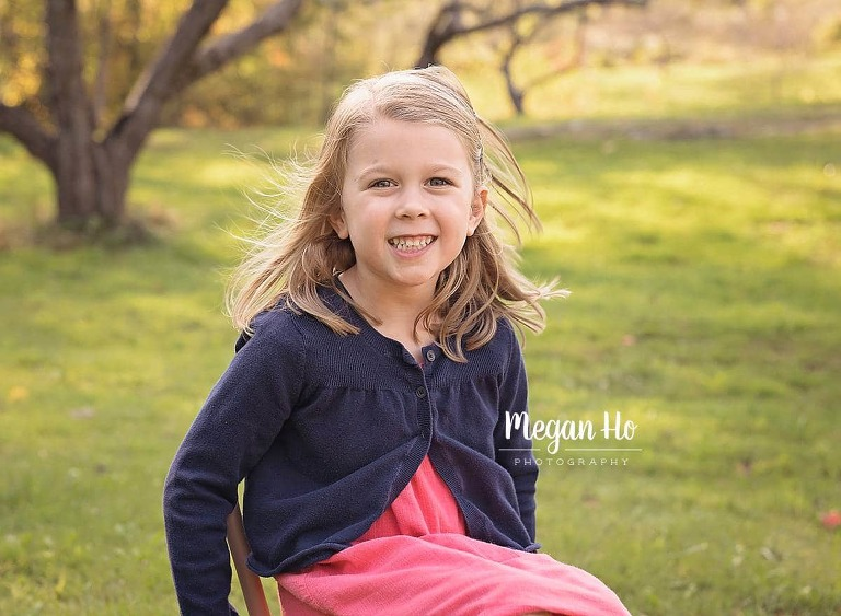 four year girl sitting in chair in fall session in Amherst nh
